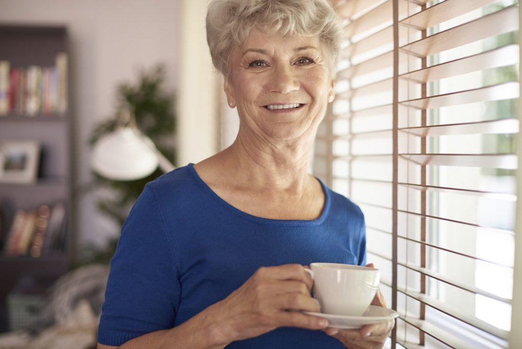 Portrait of elder woman next to the window
